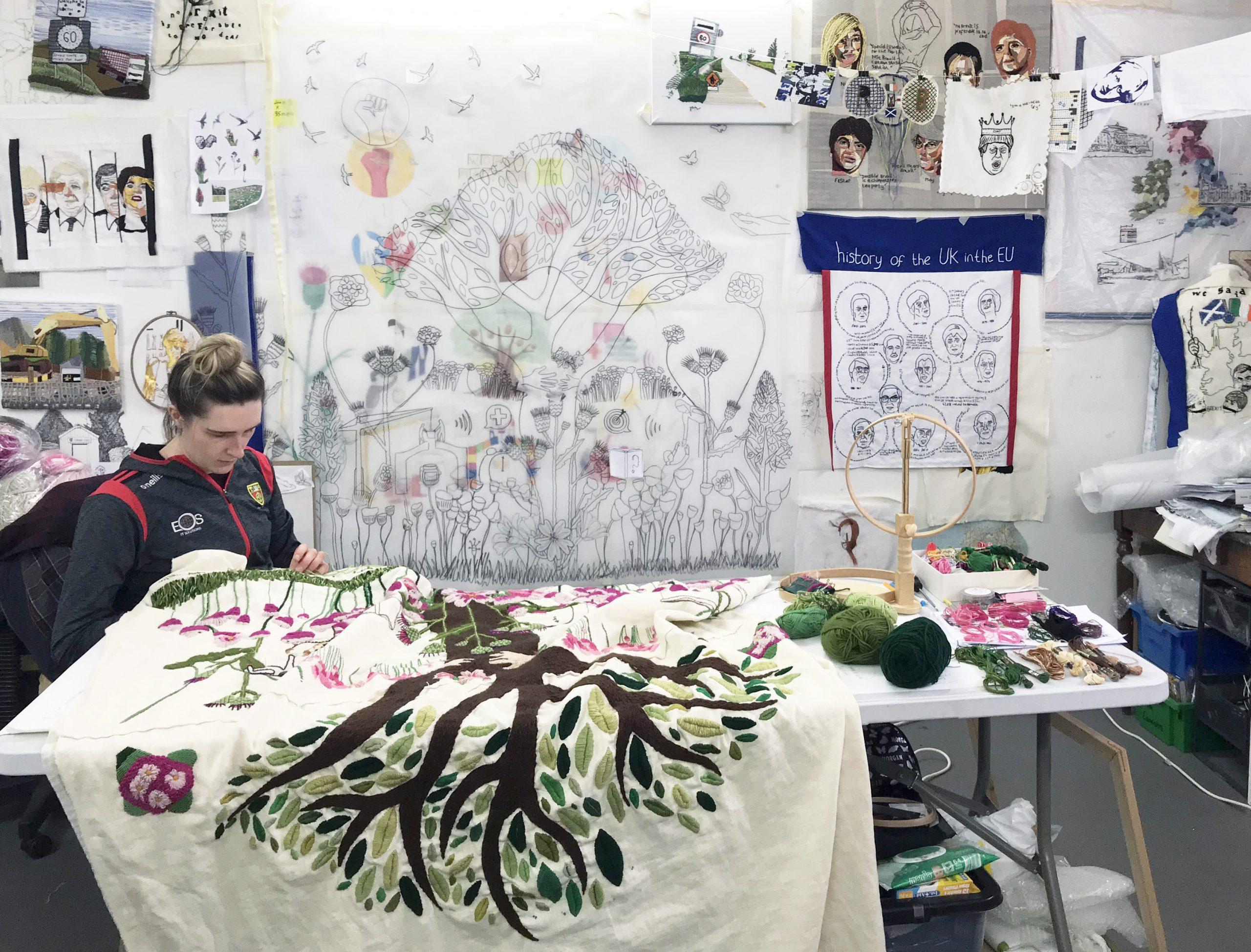 Nikkita stitching in her studio